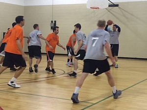 Shooting hoops in the Mens 5 vs. 5 Basketball League