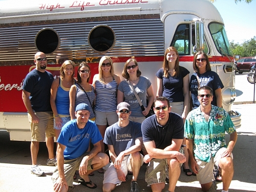 Some of the group posing for a photo by the bus outside Miller Brewery